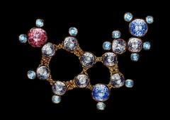 Golden Serotonin Molecule Molecular Structure With Shining Gemstones. Hand Drawn Stock Illustration