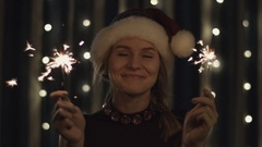 Portrait of a girl model making a wish with sparklers in their hands. Christmas Stock Footage