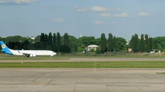 Aircraft plane is landing in an open runway strip Stock Footage