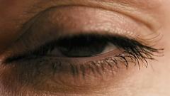 Female eye closeup slow motion Stock Footage