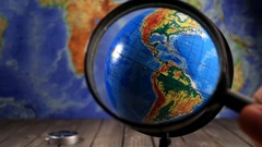Magnifying glass at the globe Stock Footage
