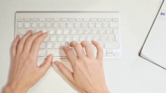 Female hands typing on a keyboard in the Office Stock Footage