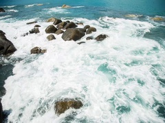 Waves covering the stones, time-lapse Stock Footage