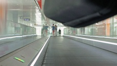 Person is walking on moving pathway in the airport Stock Footage