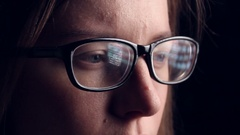 Reflected in the glasses displays. close-up Stock Footage