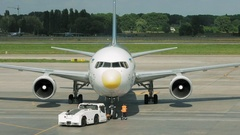 Airport crew is transporting the Lufthansa airline Stock Footage
