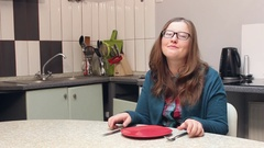 Hungry woman in the kitchen Stock Footage