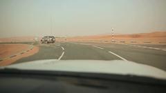 Desert highway in Abu Dhabi, United Arab Emirates Arkistovideo