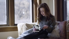 Young Woman Relaxes And Writes In Her Journal Stock Footage