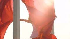 Beautiful sexy girl with aerial silk looking to the camera on the rooftop Stock Footage
