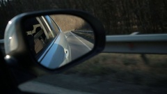 Car side mirror for rear view with traffic reflection background Stock Footage