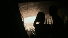 Love couple ride on a train Dubai Metro in a summer day Stock Footage