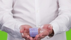 Small gift box in a man's hands. Close up. Studio Stock Footage