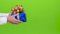 Gift. Man gives a girl the shiny blue box. Studio Stock Footage