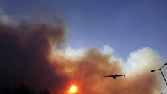 Amphibian airplane drops fire retardant on a forest fire near gas station Arkistovideo