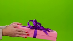 Gift of not small size shows in the hands of woman Stock Footage