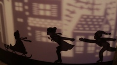 Decorative silhouettes of children skating on a sled and projection of city Stock Footage