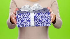 Box packed in festive paper with a bow. Gift. Studio Stock Footage