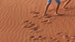 Love couple runs on the dunes of the desert Stock Footage