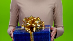 Gift in a big shiny cardboard box with a huge bow Stock Footage