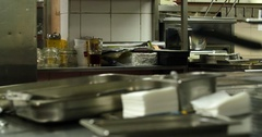 Restaurant professional kitchen interior 4k panorama video. Steel tables, chefs Stock Footage