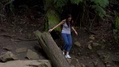 Girl Walks in the forest near Olinda Waterfalls Stock Footage