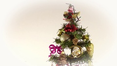Christmas tree with ornaments unde snowfall Stock Footage