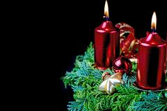 Shining Advent wreath on the black background. Stock Photos