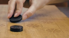 Close up of checkers on checkerboard on the table Stock Footage