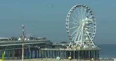 Ferris wheel on The Pier turning above sea - medium shot Stock Footage
