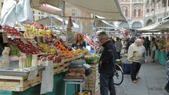Retailing at Saturday market in Piazza delle Erbe Stock Footage
