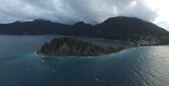 Aerial drafting sideways around the end of Scott's Head in the south of Dominica Stock Footage