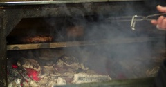 Chef prepares steak 4k video: flips meat grill charcoal oven. Barbecue kitchen Stock Footage