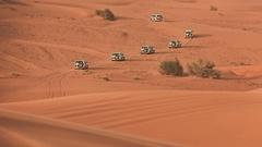 Desert Safari SUVs bashing through the arabian sand dunes Stock Footage