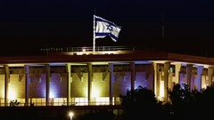 Knesset with flying waving flag of Israel at night Stock Footage
