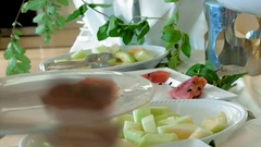 A female is grabbing some fruits from buffet Stock Footage