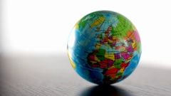 Europe Earth Globe Ball Rolling Into And Out Of Focus Stock Footage