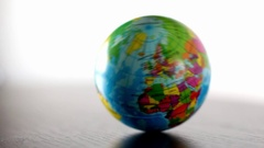 Europe Earth Globe Ball Rolling Into And Out Of Focus Seamless Loop Stock Footage