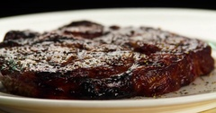Served grilled meat steak on plate 4k rotation looped video. Fried beef barbecue Stock Footage