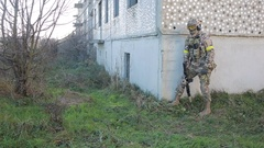 Militias are fighting. Men in camouflage with guns and playing airsoft. war Stock Footage