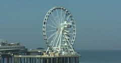 North Sea coast, Ferris wheel on The Pier turning above North Sea Stock Footage