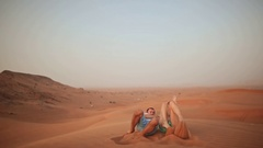 Love couple throws on a sand in the desert Stock Footage