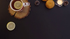 Top view woman put cookies on the table with tea and candles hands from above. Stock Footage