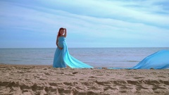 Pregnant woman in blue dress posing on beach. Beach holiday. Romantic woman Stock Footage