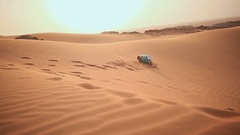 Love couple somersault in the desert sands Stock Footage