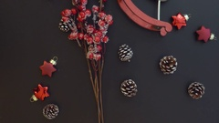 Top view red branch on a dark table with Christmas decoration Stock Footage