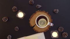 Top view  the book on the table with tea and candles Stock Footage