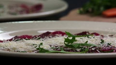 Serving carpaccio meat rucola slow motion сlose up HD video. Restaurant kitchen Stock Footage