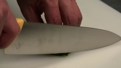 Chef cutting knife green herbs slow motion сlose up HD video. Restaurant Stock Footage