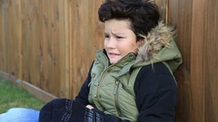 Young boy, kid in winter clothes trying to warm 2 Stock Footage